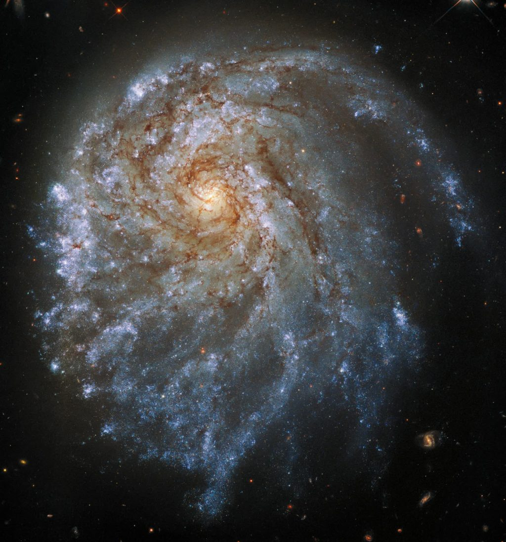 The Hubble Space Telescope takes a closer look at an unusual spiral galaxy 120 million light-years away
